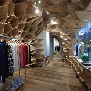 Influenced by the organic patterns found in plants, Kengo Kuma has created this shop and café in Tokyo for fashion designer Lucien Pellat-Finet. In his design, Kuma uses a honeycomb structure comprised of Lauan-made plywood to envelope the space. This three-dimensional structure ingeniously serves as the retail display system used throughout the shop; with the natural warmth of wood complementing a fashion line notorious for its assemblage of iconic cashmere sweaters.