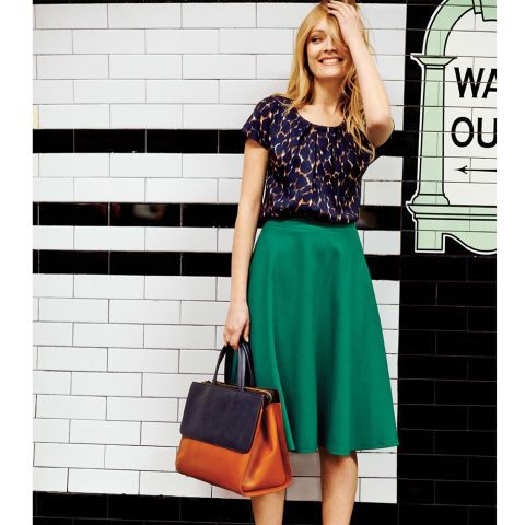 FLAUNT A FULL SKIRT This season it's all about swingy skirts which for bottom-heavy figures are a godsend. A skirt with slight volume de-emphasises the width of your hips by hugging the waist then falling away to skim over troublesome bum and thighs. With fuller skirts, it's always best to keep the top half more fitted to balance proportions, and make sure to tuck in too. Boden skirt, £79 and Boden top, £49.