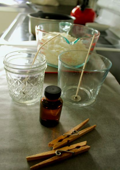 Raid your kitchen for supplies! Here's how to repurpose glass jars into DIY soy candles. Soy candles are so much lovelier than paraffin or palm oil candles. Here's how to DIY your own with essential oils and mason jars you already have! #soycandles #DIYcandle #candle #essentialoils #masonjar