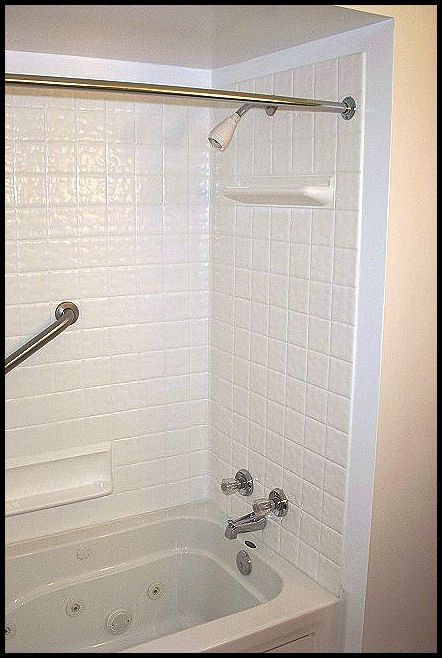 towels and other bathroom items en suite shower with storage next to