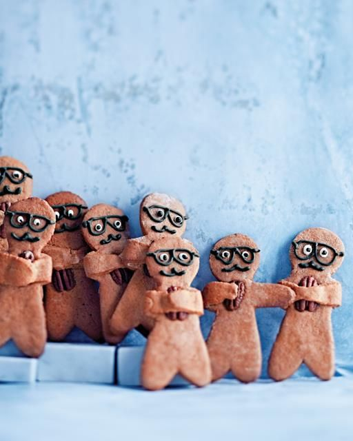 Traditional gingerbread men get a new look once you draw them specs with royal icing and give them tasty nuts to hold.