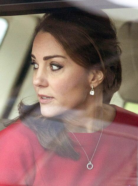 British Royalty. This is first time I see this picture for Duchess Kate from the car, and she is following something from the window.