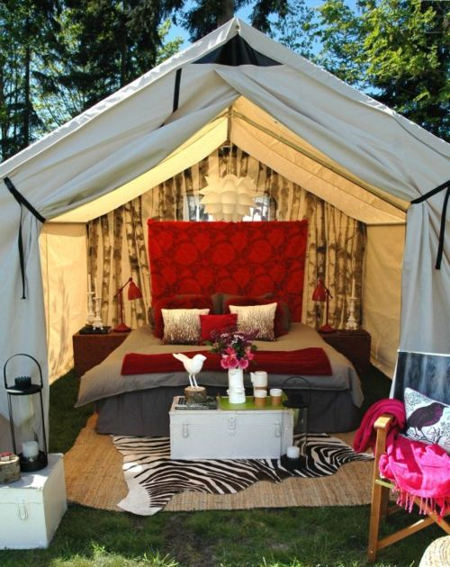 outdoor bedroom. those tents stay super warm in the winter with a wood stove inside!