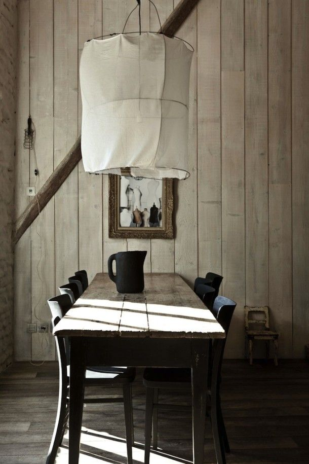 Dining area with wooden table and walls