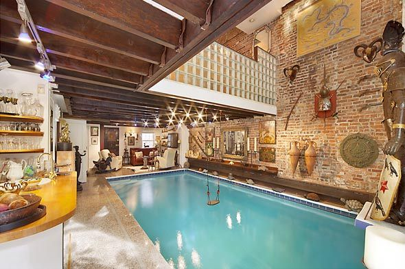 There's a swing over a pool inside a house. My dream