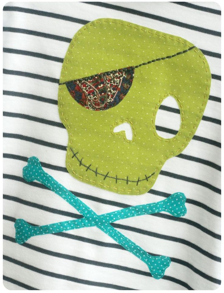 Applique pirate - What a fun idea for making a simple shirt or top more interesting. You could do this in any number of creative ways for kids' and adults' clothes alike!!!