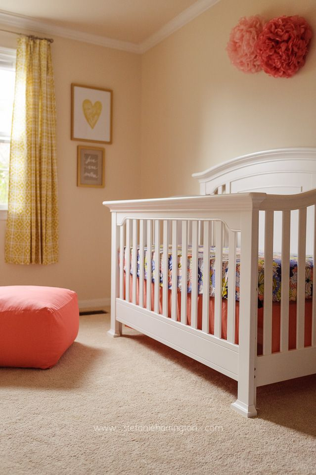 Pretty colors in this baby nursery - Coral, Periwinkle, Gold and Citron