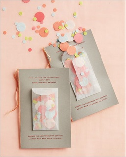 confetti pouches on the wedding programmes - shame we're not allowed confetti at the church!