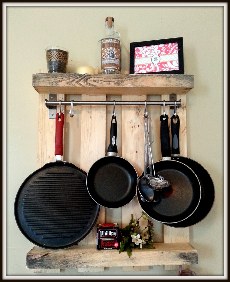 I made this using a pallet I pulled out of the dumpster at work, a cheap Ikea kitchen rail and some left over shower curtain hooks to hold the pots and pans.