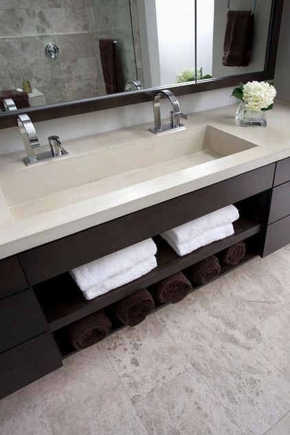 The sink is integrated into one long piece of concrete and has his-and-her faucets. The countertop with the built-in sink included cost about $2,500 — less than a high-end stone counter plus sinks would have cost, Duebber says.