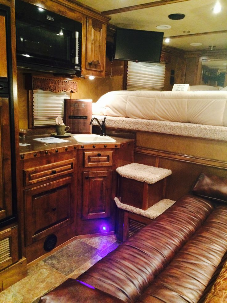 """4-Star 3H with 11'6"""" Outlaw Conversion. Dark maple hardwood cabinets, custom sofa sleeper, large fridge with freezer, 2 burner cooktop, microwave/convection oven, porcelain kitchen sink, DirecTV, ducted heat and air and 4.0 Onan generator! LQ living quarters custom live in trailer aluminum horse"""
