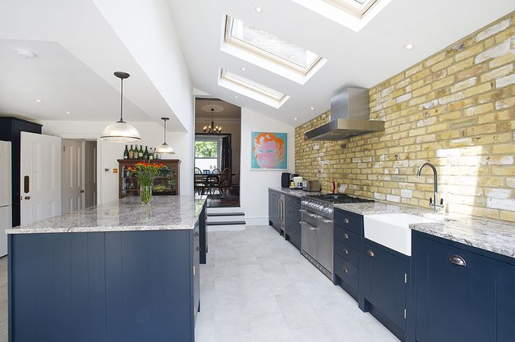 Peckham Rye, SE15, Side return extension on a Victorian Terraced House in Peckham Rye SE15, Greater London, Pitched Roof with Velux, Open Plan Design, Contemporary Kitchen, Kitchen Extension, Bi-Fold Doors, Large Kitchen Island, Kitchen Extension Ideas, Kitchen Interior, Kitchen Design Ideas, Full House Refurbishment, Tile Floors, Marble Worktop, Pendant Lighting
