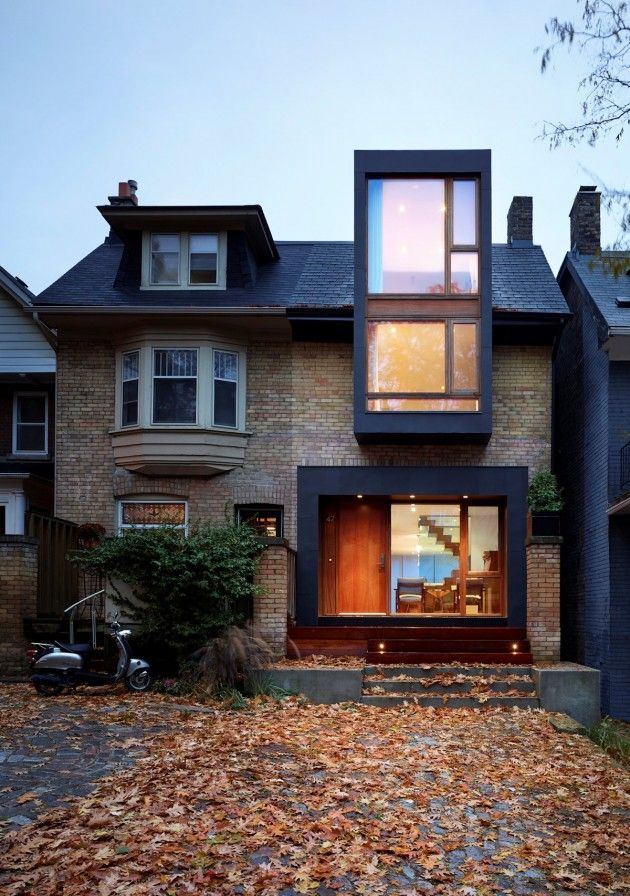 Drew Mandel Architects completed the renovation and addition of a 100 year old semi-detached family home in Toronto, Canada.