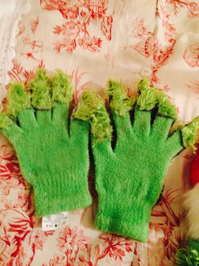 How to make grinch gloves. I bought a pair of lime green  cheap winter gloves they cost like $1.00 at Walmart. I took the left over fur rug scaps and hot glued them to the fingers on the underside I cut longer than the gloves to make it look like grinch hands.