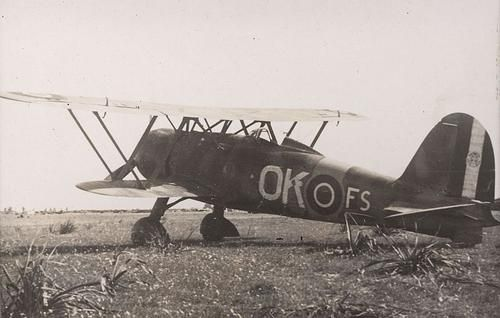 """OK-FS: an Italian fighter Fiat CR.42 """"Falco"""" (Hawk) captured intact on Tripoli Castel Benito Airfield on January 1943, after the Axis retreat, and """"enlisted"""" by the No 450 Squadron Royal Australian Air Force which was deployed here from 24 January 1943 until 14 February 1943."""