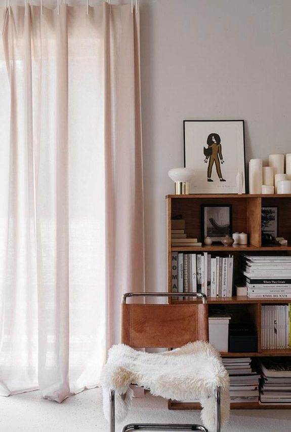 Light pink curtains with light brown leather and chrome chair with faux fur cover. / sfgi