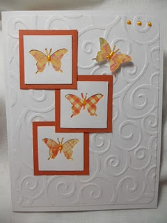Punched butterflies over patterend paper....why didn't I think of that? They are
