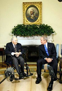 Frank Buckles in a wheel chair is talking to George W. Bush. Frank Woodruff Buckles (born Wood Buckles, February 1, 1901 – February 27, 2011) was a United States Army soldier and the last surviving American veteran of World War I. He enlisted in the U.S. Army in 1917 and served with a detachment from Fort Riley, driving ambulances and motorcycles near the front lines in Europe.