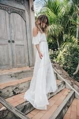 Please Note: we currently aren't able to ship out Bridal Gowns from the US but you can place your order on our Australian Website here. The Elizabeth gown is a divinely light and flowing dress that's full in volume while still feeling like a simple, cotton sundress. The gown has delicate pin tucks and slightly contrasting cream lace trims between the tiers, all adding to a paired back, almost carefree vintage feel. The off shoulder frill detail gives the dress a feminine touch. size & fit...