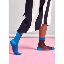 Our Filippa Nylon Ankle sock will totally transform your everyday look. These socks are half sheer, half opaque for an understated and unique contrast. We've teamed two bold colors in this design, a rich cerulean blue and deep black, emphasized by a bright cerulean blue heel, toe and slim cuff. Our Filippa Nylon Ankle sock is made of a lightweight nylon for a delicate texture and silky feel. Available in size 36-41.