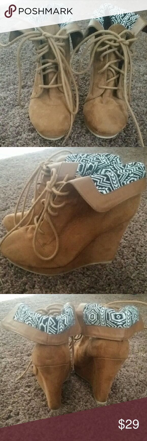 Tan wedge booties Tan lace up wedge booties, slight platform, black and white fold-over cuff.   Surprisingly comfortable.  Only worn about 3 times.  Size 7.5 shi Shoes Ankle Boots & Booties