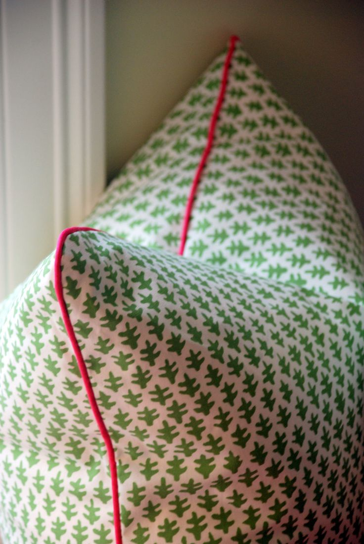 "Sister Parish ""Burmese"" Decorative Pillow Covers - Green and White Geometric Batik Print with Pink Piping"