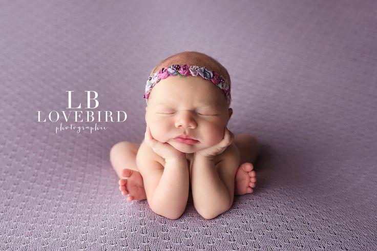 Woodlands newborn photographer hands under chin pose