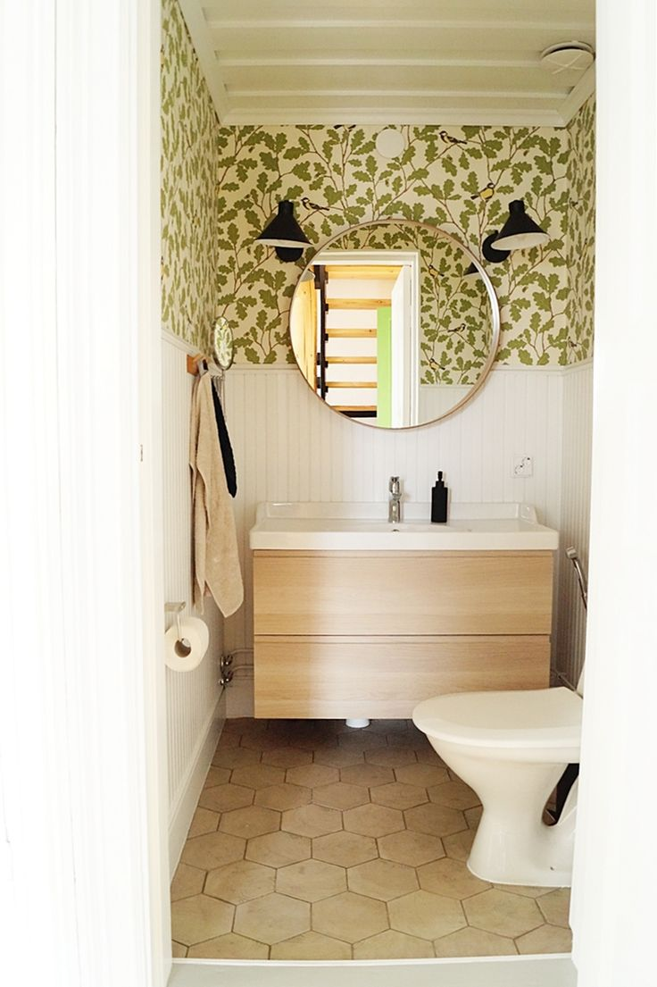 Our new renovated toilet. So lovely!  toilet, renovation, old house, Sandberg Waldemar wallpaper, Pukkila Hexawood tiles, Ikea Godmorgon, Ikea Stocholm mirror, Clas Ohlson Industry lights, panel wall