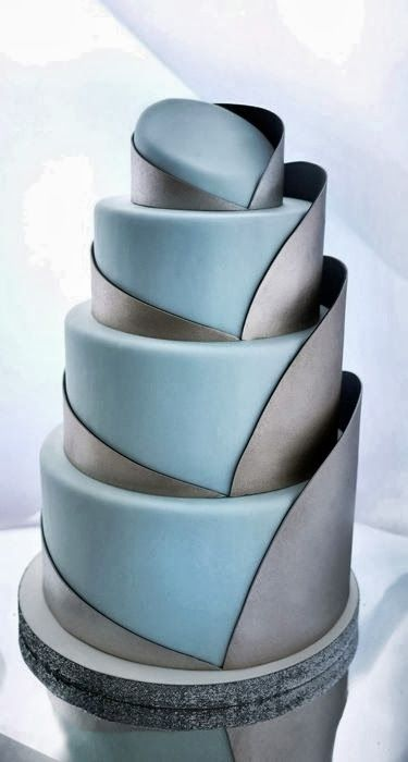 We are big fans of sculptural and architectural designs.  Unique Wedding cake Visit http://www.brides-book.com for more great wedding resources