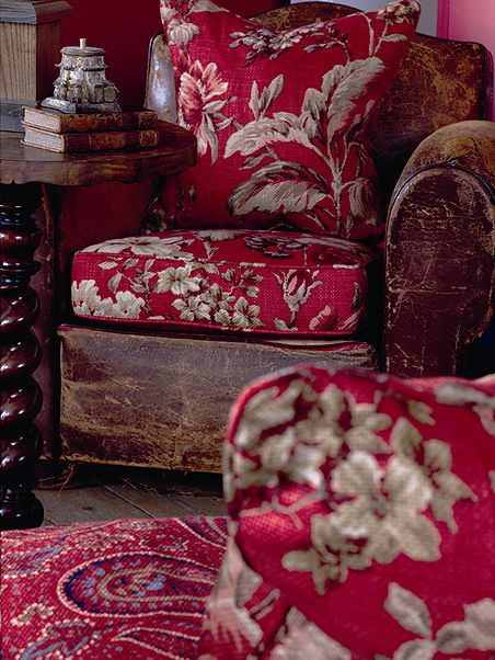 love the old leather armchair with red floral cushions #cushion #pillow #floral