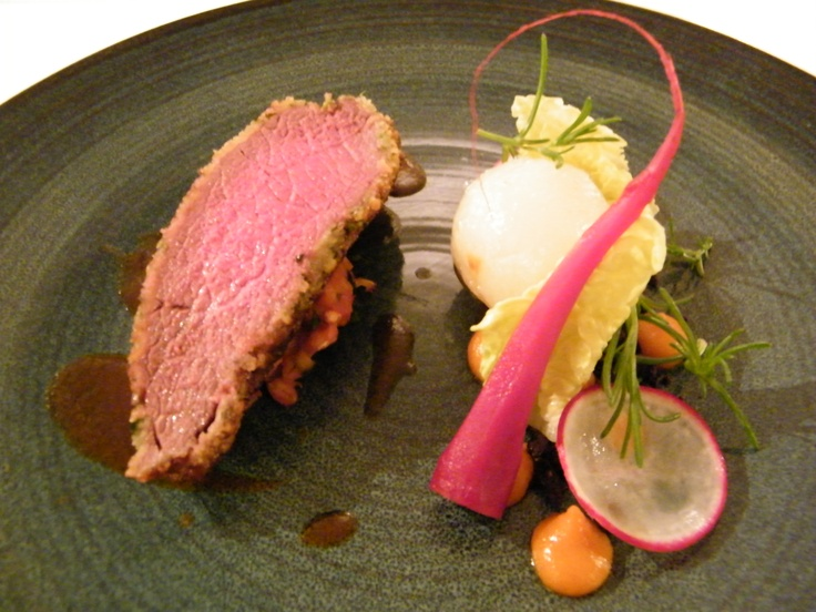 Herb-crusted loin of New Zealand venison, potato, pearl barley, heirloom carrot & cocoa