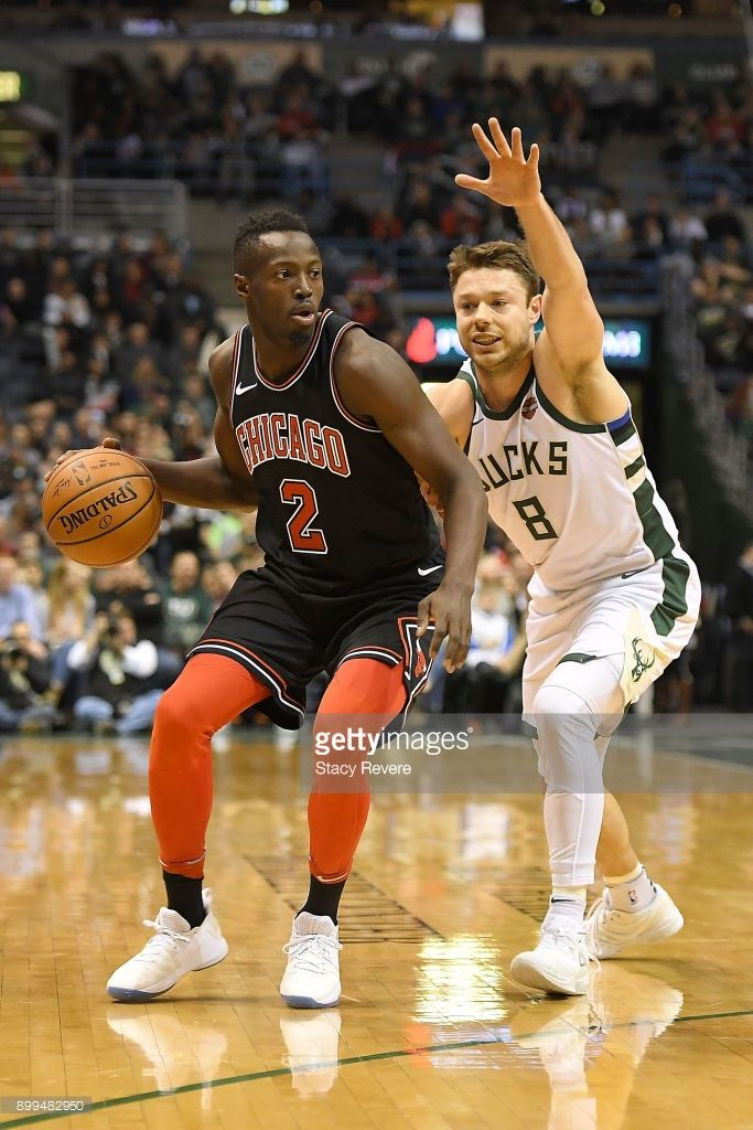 News Photo : Jerian Grant of the Chicago Bulls is defended by...