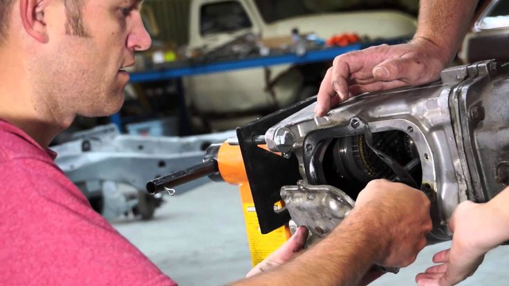 The Build team is working on dismantling the Muncie transmission. They'll show you everything from draining the gear oil, removing the hurst shifter, linkage, and more. Enjoy! And be sure to follow along on Facebook: https://www.facebook.com/AmericanModernCollectorCar @American Modern Insurance Group