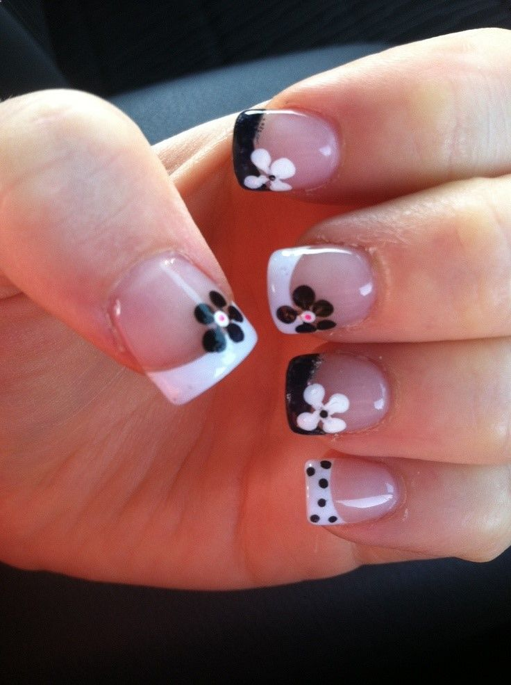 I love the idea, but I dont like every other nail different. Black and White French Tips with Contrasting Flowers!