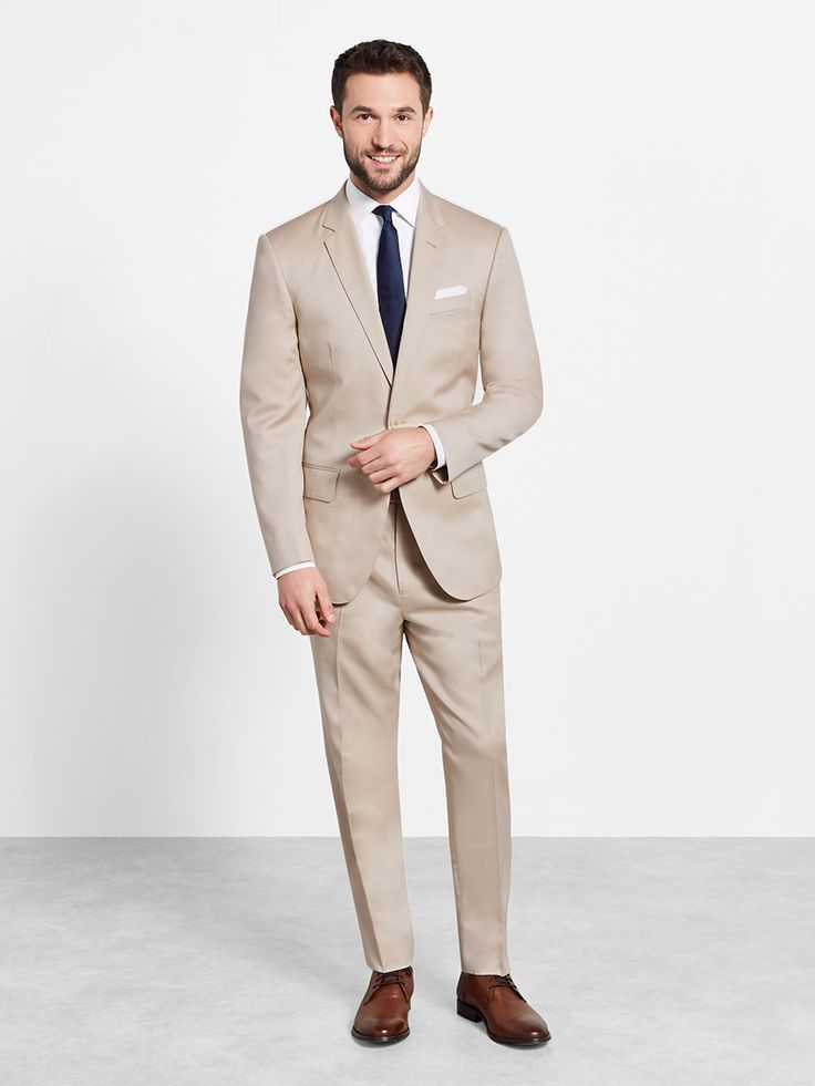 Tan Suit by Ovadia and Sons. Lighten up in the perfect tan suit. Great for warm weather events, this two-button, notch lapel suit can be as serious or laid back as the accessories you pair it with.