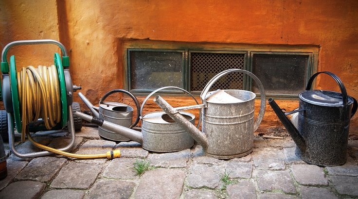 Charming, Colourful Watering Cans in a courtyard in Copenhagen City Centre. Street Photography