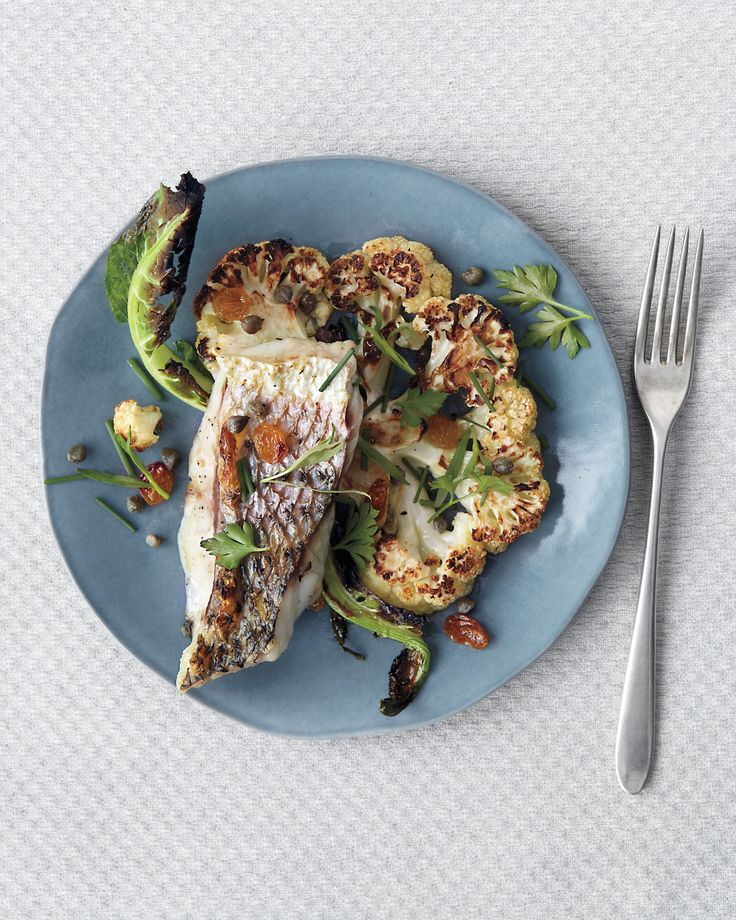 Another firm-fleshed fish, such as halibut or salmon, can be substituted for the striped bass. Broilers vary in heat intensity; move the rack to a lower position if the cauliflower or fish is browning too quickly, or to a higher rack if too slowly.