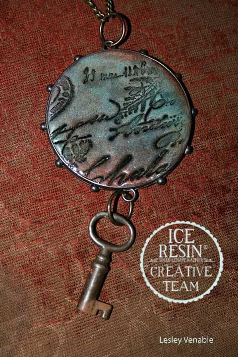 iceresin - bezel filled with air clay, stamped, cured, colored, and then sealed with resin on top - COOL!