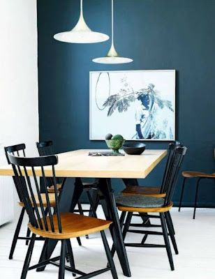 The paint treatment on the chairs (black + honey stained wood) really gives them a modern yet warm touch