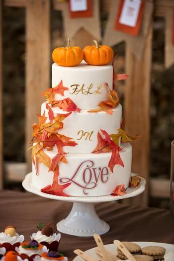 fall wedding cake with pumpkins