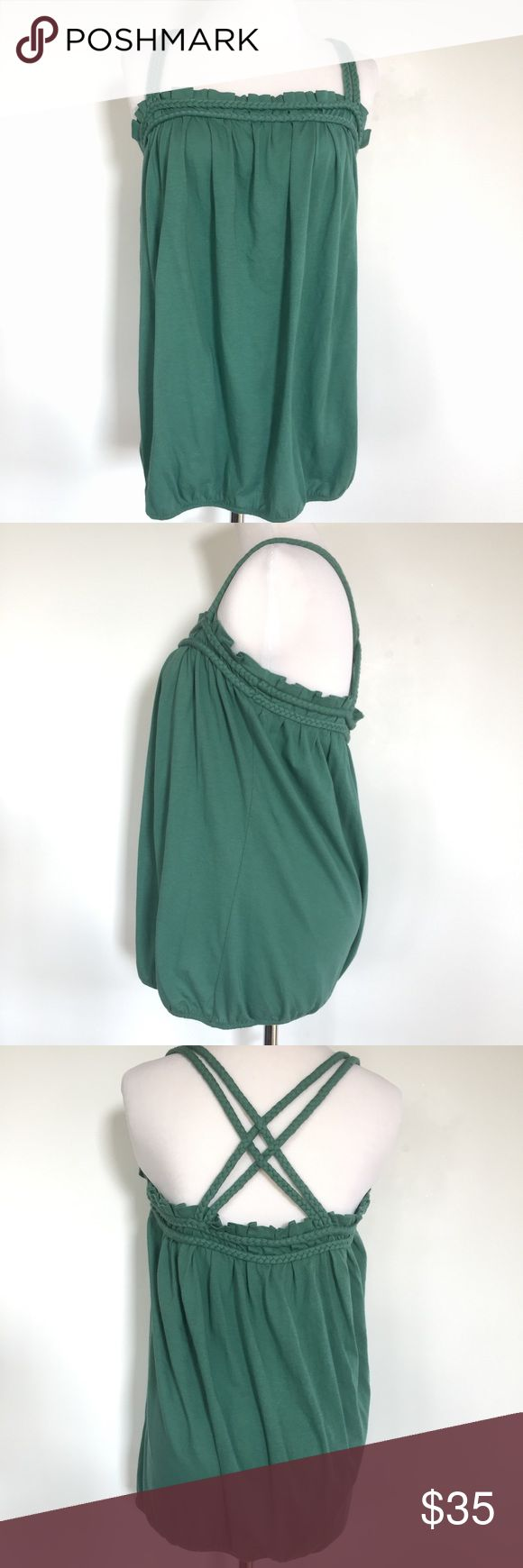 BCBGeneration Braided Top New with Tags! Pretty teal tank top with braided straps that crisscross in the back.  Elasticized bubble hem.  Very flattering on, just too big for me now. BCBGeneration Tops Tank Tops