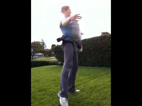 standing baby wearing workout