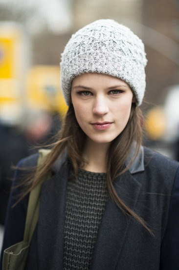 Warm and cute with straight hair and a hat. See more of our #NYFW street style snaps!