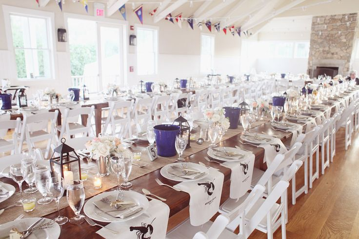 Awesome dinner set up for lobster bake after a rustic beach wedding at the Vineyard Haven Yacht Club on Martha's Vineyard, MA.