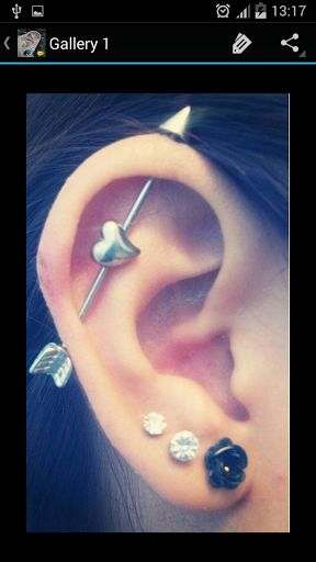 """An industrial piercing (North America), sometimes called the """" bar """", scaffold piercing or construction piercing, is any two pierced holes connected with a single straight piece of jewelry (compare to orbital piercing); however, it typically refers to a double perforation of the upper ear cartilage specifically. Two piercings are made, one fairly close to the head (anti-helix piercing) the second further down the cartilage, on the opposite side of the ear (helix piercing). A straight barbell…"""