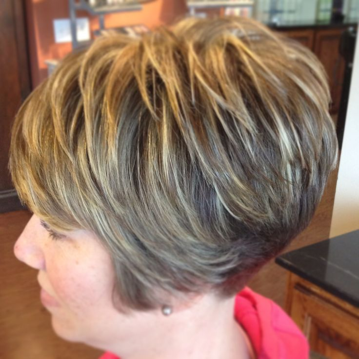 Bold blonde highlights with a sort & sassy cut!