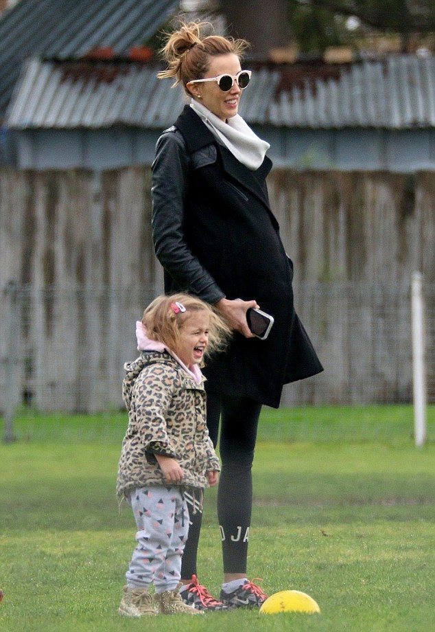Mummy daughter time: Bec eventually got Billie her to stand still on the sideline, where s...
