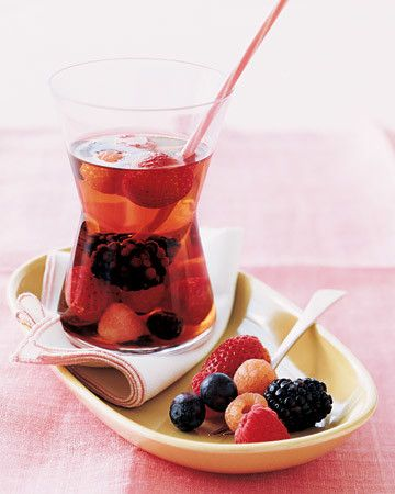 This blushing pink sangria is made with rose wine and white cranberry juice. Begin by macerating blueberries, blackberries, strawberries, and raspberries in sugar and raspberry liqueur for an hour, then add the wine and juice.