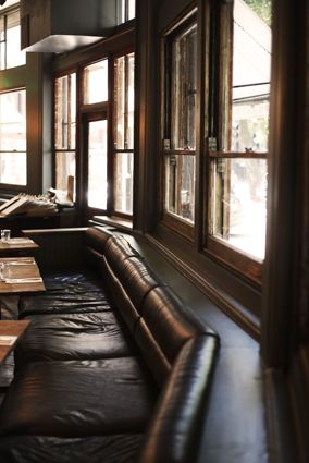 Leather sofa seating, comfortable relaxed dining. www.paesanlondon.com