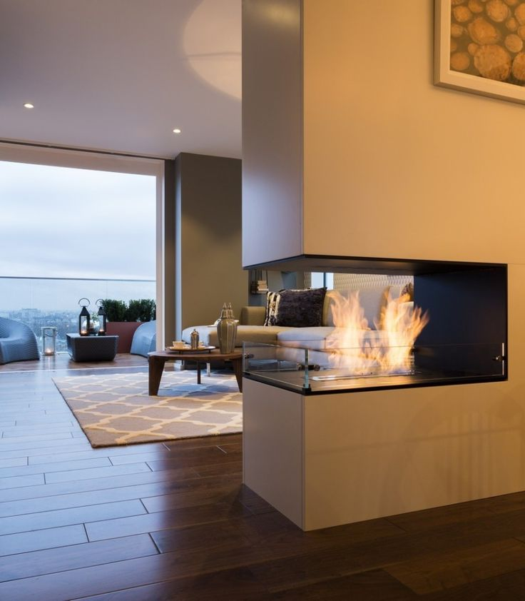 Home & Apartment, Feature Bespoke Double Sided Fireplace The Filaments Penthouse Collection Suna Interior Design Ideas Wooden Flooring Carpet Flooring Living Room Design Ideas Modern Fireplace Ideas Brown Sofa Wooden Table: Striking Three Bedroom Duplex Exuding a Vivid Personality in London